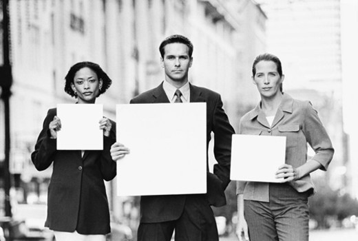 Three people holding blank paper : Stock Photo