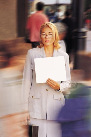 Businesswoman holding blank paper : Stock Photo