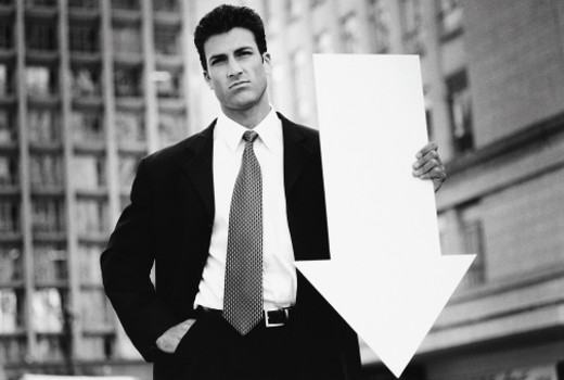 Stock Photo: 1527R-324092 Businessman holding arrow