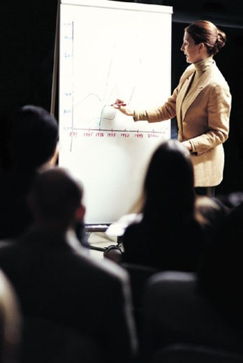 Stock Photo: 1527R-340070 Businesswoman giving a presentation
