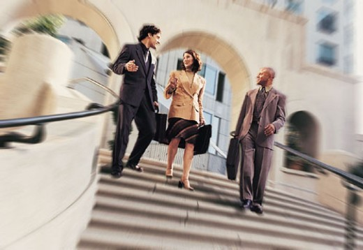 Stock Photo: 1527R-340073 Three businesspeople walking down stairs