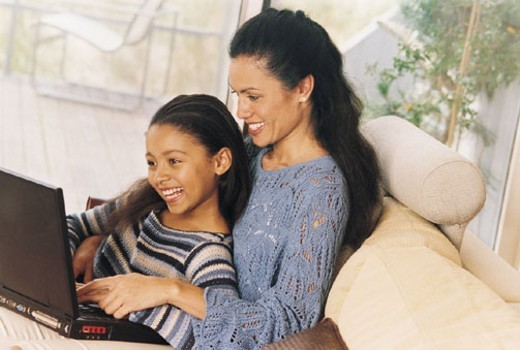 Stock Photo: 1527R-382063 Mother and Daughter Using Laptop Computer