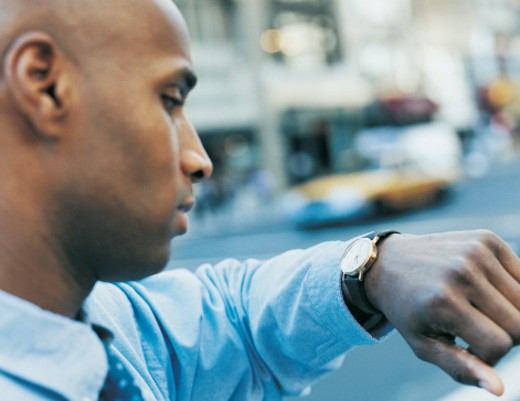 Stock Photo: 1527R-398053 Businessman Checking Watch