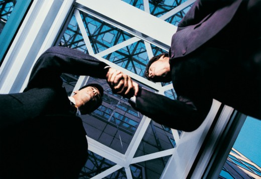 Stock Photo: 1527R-414042 Low Angle View of Two Businessmen Shaking Hands