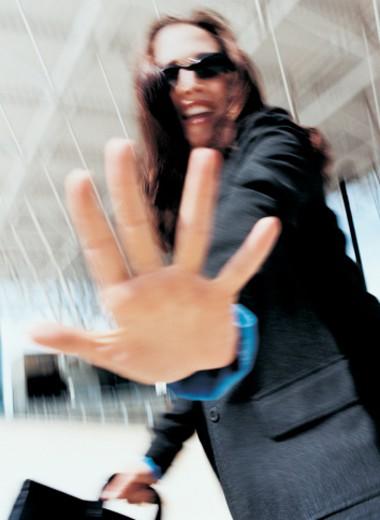Businesswoman Blocking Camera with Hand : Stock Photo