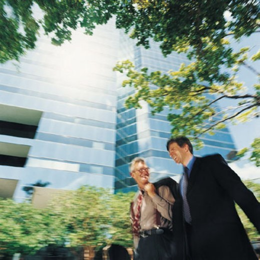 Businessmen Walking Outdoors : Stock Photo