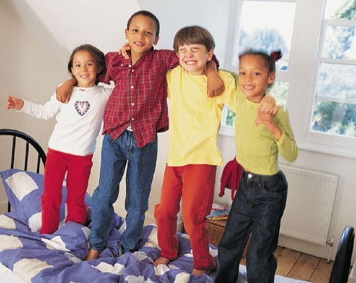 Portrait of Four Children in Bedroom : Stock Photo