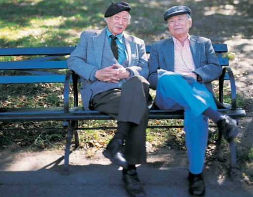 Portrait of Two Old Men Sitting on a Park Bench : Stock Photo