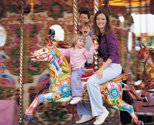 Family on a Carousel : Stock Photo