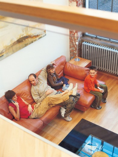 Stock Photo: 1527R-457079 Family Relaxing on a Sofa in an Apartment