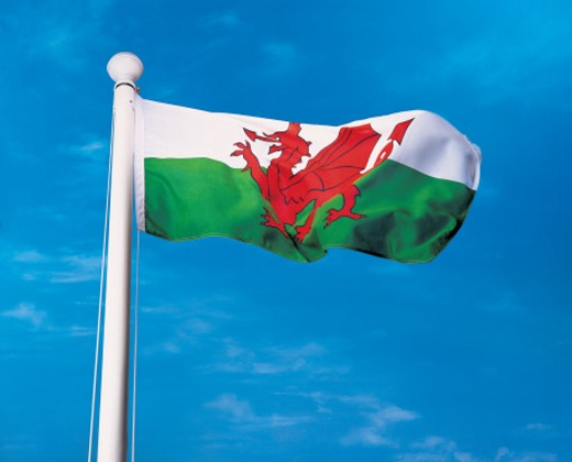 Stock Photo: 1527R-47001 Flag of Wales on flagpole waving in wind
