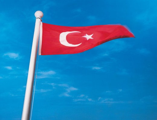 Flag of Turkey on flagpole waving in the wind : Stock Photo