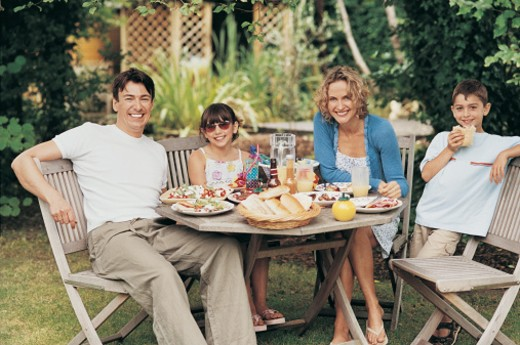 Portrait of a Family at Lunch in the Garden : Stock Photo