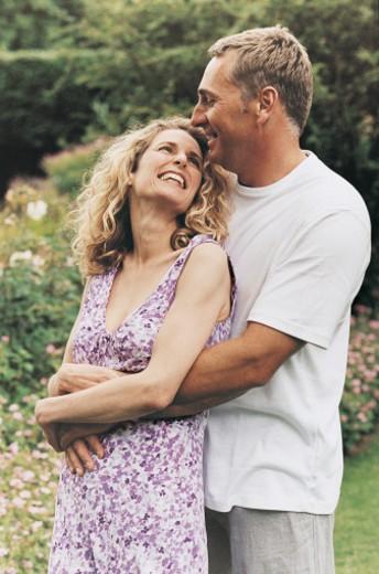 Stock Photo: 1527R-493088 Couple Embracing in Their Garden