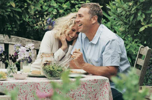 Stock Photo: 1527R-493093 Couple Having Lunch in Their Garden