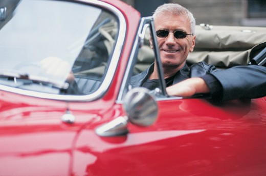 Stock Photo: 1527R-498092 Portrait of a Mature Adult in a Convertible
