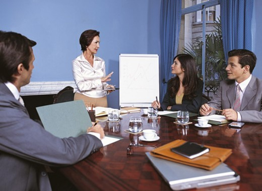 Stock Photo: 1527R-508015 Businesswoman Explaining to Colleagues