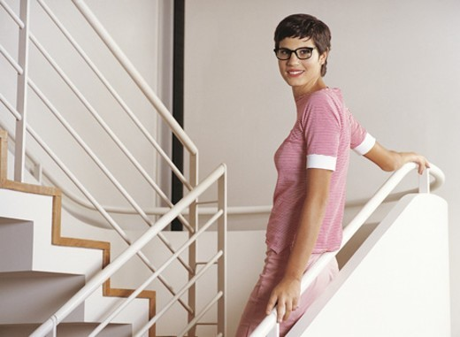 Stock Photo: 1527R-508047 Portrait of a Young Businesswoman Wearing Spectacles Standing on a Stairway