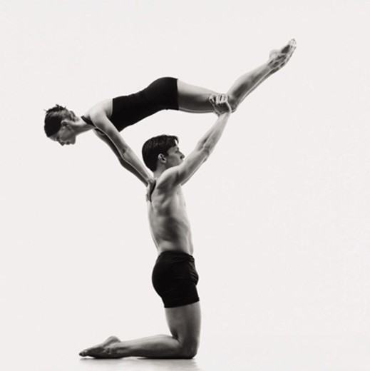 Stock Photo: 1527R-517025 Kneeling Male Dancer Holding Woman in the Air