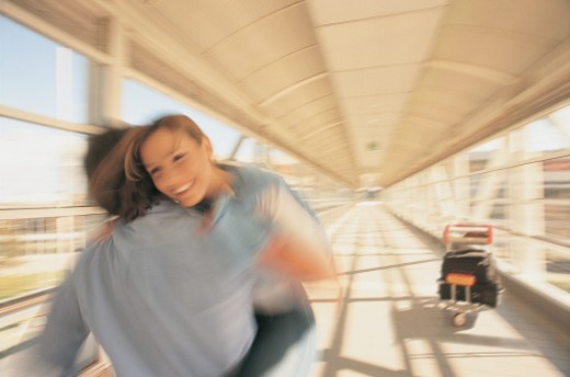 Couple Cuddling at the Airport : Stock Photo