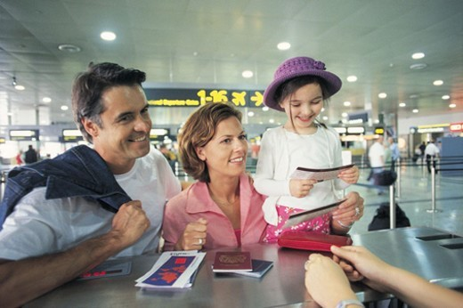 Stock Photo: 1527R-523068 Family Standing at the Airport Check In
