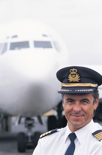 Stock Photo: 1527R-523072 Portrait of a Pilot Standing in Front of an Aeroplane