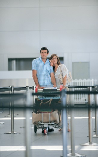 Couple Standing at Airport Having Missed Their Plane : Stock Photo