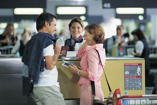 Couple Holding Their Passports at the Airport Check In : Stock Photo