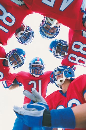 American Footballers Planning Their Game : Stock Photo