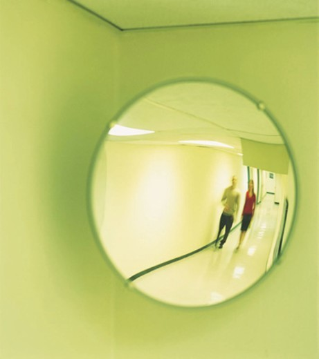 Two Business Colleagues Walking Down a Corridor, Reflected in a Surveillance Mirror : Stock Photo