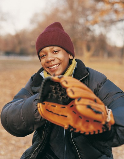 Stock Photo: 1527R-592091 Portrait of a Boy in a Park wearing a Baseball Glove