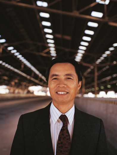 Stock Photo: 1527R-604062 Portrait of a CEO Standing in a Factory