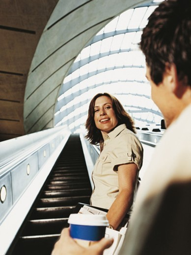 Stock Photo: 1527R-641003 Man Chatting Up a Businesswoman on an Escalator