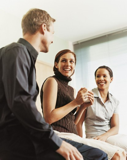 Businessman and Businesswomen Chatting on Their Coffee Break : Stock Photo