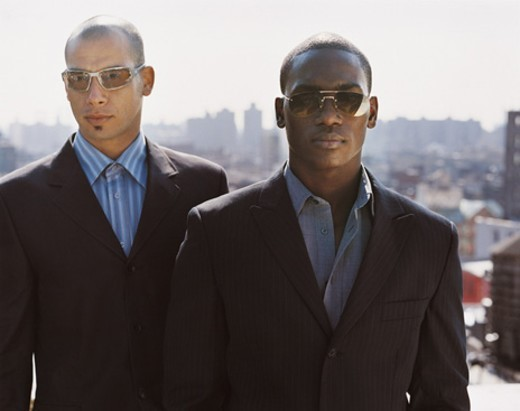 Portrait of Stylish Serious Businessmen Standing Outdoors in a City : Stock Photo