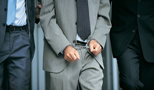 Stock Photo: 1527R-658004 Close up of a Businessman Wearing Handcuffs Between Two Men