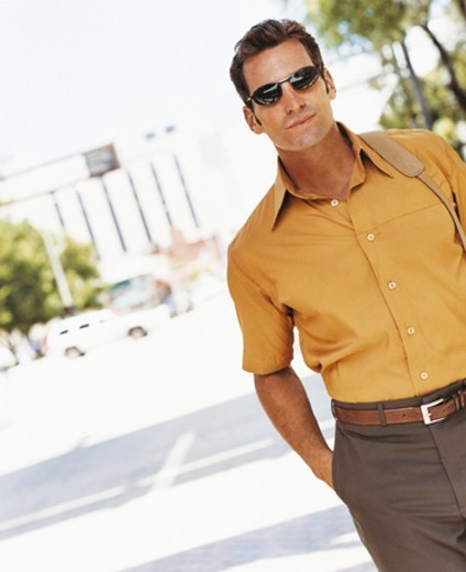 Stock Photo: 1527R-670059 Portrait of a Stylish Businessman Wearing Sunglasses
