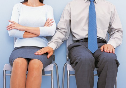 Stock Photo: 1527R-671052 Mid Section View of a Businessman Touching the Thigh of a Businesswoman Sitting by Him