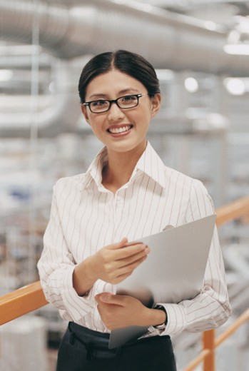 Stock Photo: 1527R-678009 Portrait of a Businesswoman Holding a Clipboard