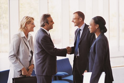 Stock Photo: 1527R-678045 Businessmen and Businesswomen Arriving and Shaking Hands in a Lobby