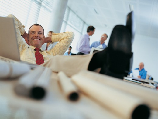 Businessman Relaxing With His Feet Up on a Desk : Stock Photo