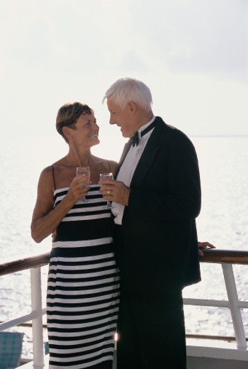 Stock Photo: 1527R-681064 Senior Couple Enjoying a Glass of White Wine on the Deck of a Cruise Liner