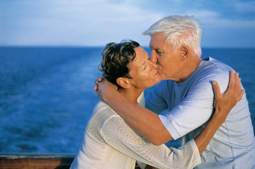 Couple Kissing on Deck at the Stern of a Cruise Liner : Stock Photo