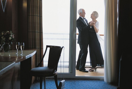 Mature Couple Dancing on the Deck of a Cruise Liner Outside their Cabin : Stock Photo
