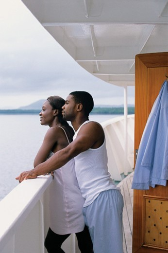Stock Photo: 1527R-681091 Couple Standing on the Deck of a Cruise Liner and Enjoying the View