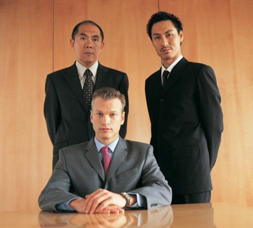 Portrait of Three Business Executives By a Table : Stock Photo
