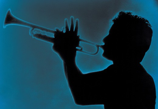 Profile of man playing trumpet : Stock Photo