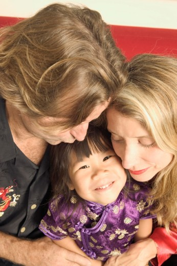 Stock Photo: 1530R-10014 Portrait of parents with their daughter.