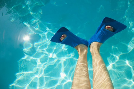 Overhead view of feet in swim fins. : Stock Photo
