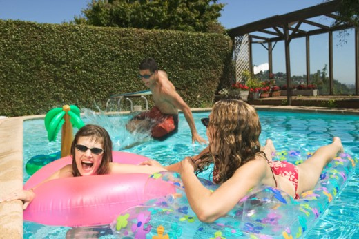 A group of teenage kids playing in a pool.   : Stock Photo
